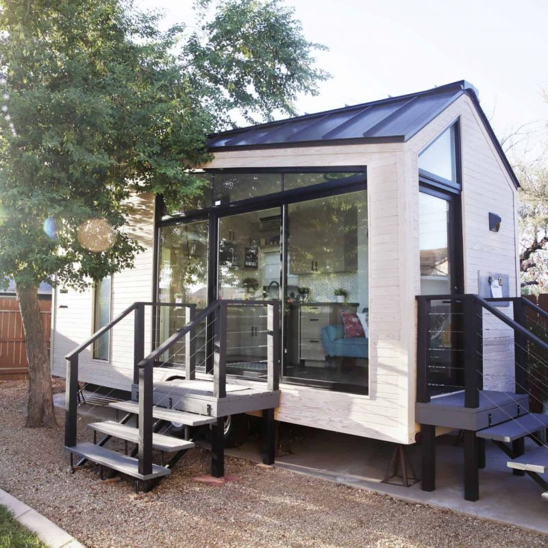 tiny-house-with-large-glass-windows-sits-in-the-royalty-free-image-1051469438-1546902448
